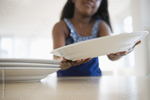Black girl setting the table
