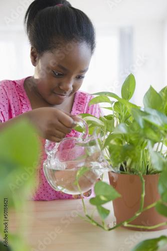 Black girl watering plants