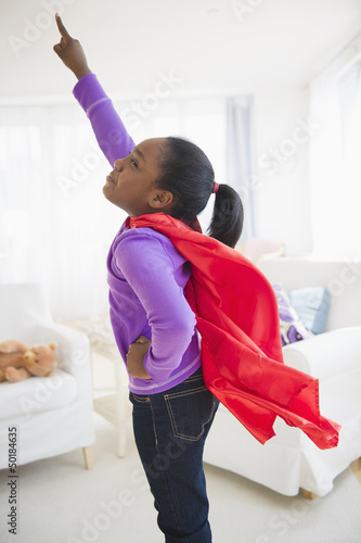 Black girl pretending to be a superhero