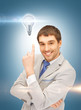 man in suit with light bulb