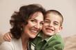 Caucasian grandmother hugging grandson