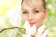 beautiful woman with orchid flower and butterflies