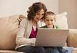 Caucasian grandmother and granddaughter using laptop