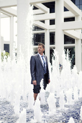 Caucasian businessman standing in fountain
