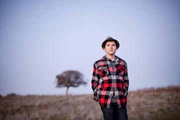 Caucasian boy standing in field