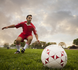 Hispanic soccer player about to kick the ball