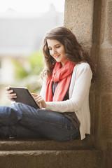 Caucasian woman using digital tablet