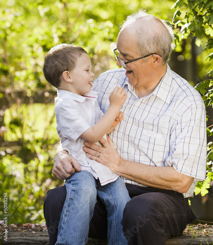 Caucasian grandfather talking with grandson