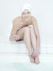 Caucasian woman dipping toe in water