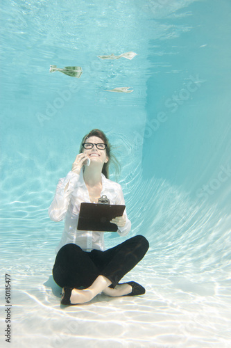 Caucasian businesswoman sitting underwater