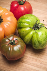 Four colorful tomatoes