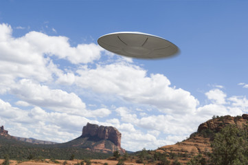 UFO flying over desert