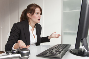 Frustrated businesswoman looking at computer