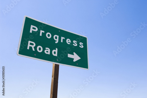 Sign with arrow toward Progress Road