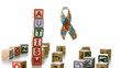 Autism ribbon falling beside blocks spelling autism