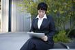 Businesswoman using digital tablet outdoors