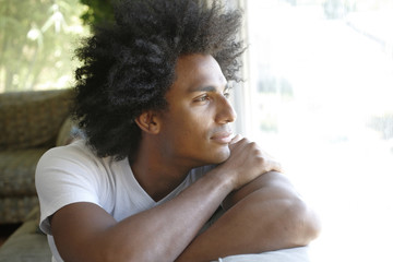 Man sitting on sofa thinking