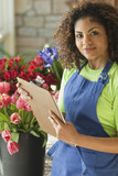 Mixed race florist holding clipboard