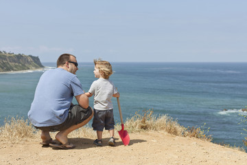 Caucasian father and son on beach