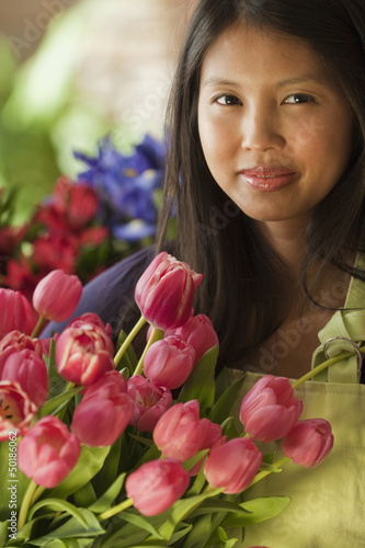 Asian florist holding tulips