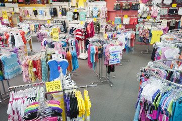 Children's clothing on racks in store