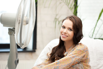 happy and smiling woman sitting near ventilator