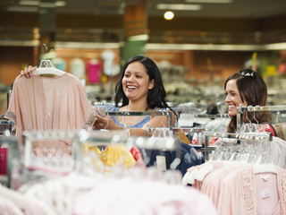 Friends shopping in clothing in store