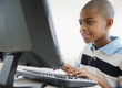African American boy using computer
