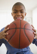 African American boy holding basketball