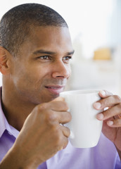 Mixed race man drinking coffee