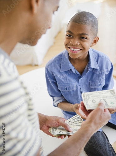 Father giving son money