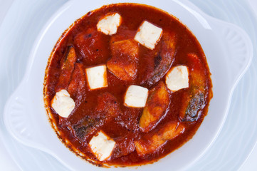 Fish in tomato sauce and cheese.