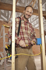 Caucasian electrician working on construction site