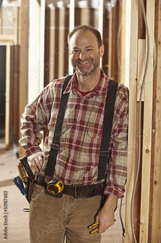 Caucasian carpenter working on construction site