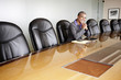 Black businesswoman sitting in empty conference room