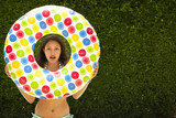 Mixed race girl holding inflatable ring