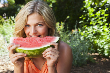 Caucasian girl eating watermelon