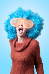 funny girl with blue wig and big blue eyeglasses