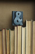 Ampersand sign on top of books