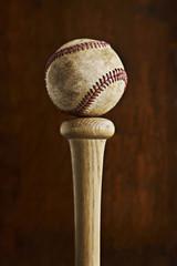 Baseball balancing on baseball bat