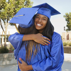 Happy graduates hugging