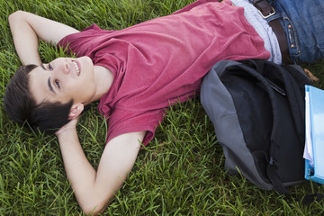 Caucasian man laying in grass relaxing