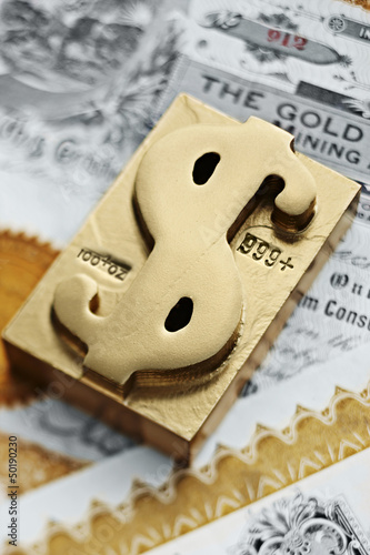 Gold ingot with dollar sign symbol