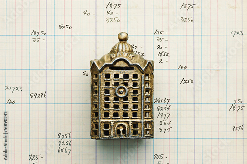 Small building replica on graph paper