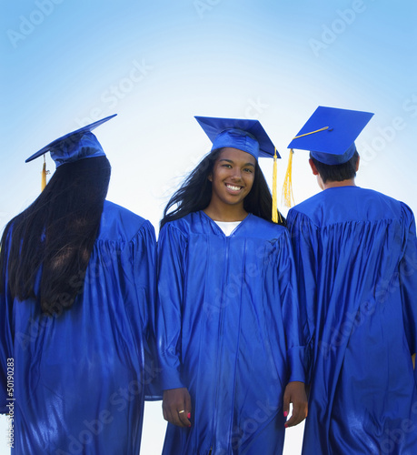 Friends in graduation caps and gowns