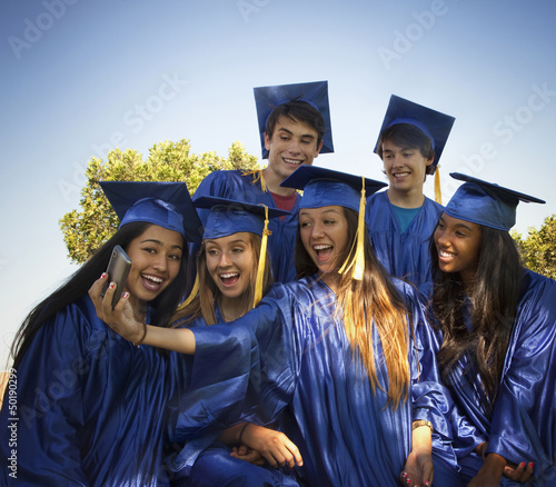 Graduates taking self-portrait