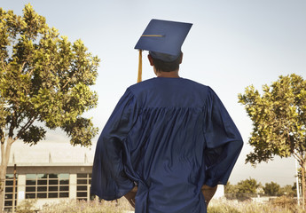 Rear view of graduate in cap and gown