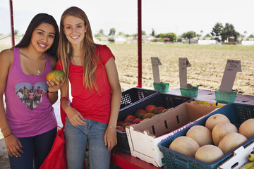Teenage girls shopping at fruit stand