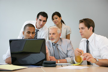 Business team sitting at a computer