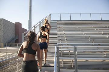 Teenage runners training on stadium bleachers